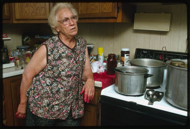 Sadie Miller in her kitchen canning beets from her garden using the hot water process