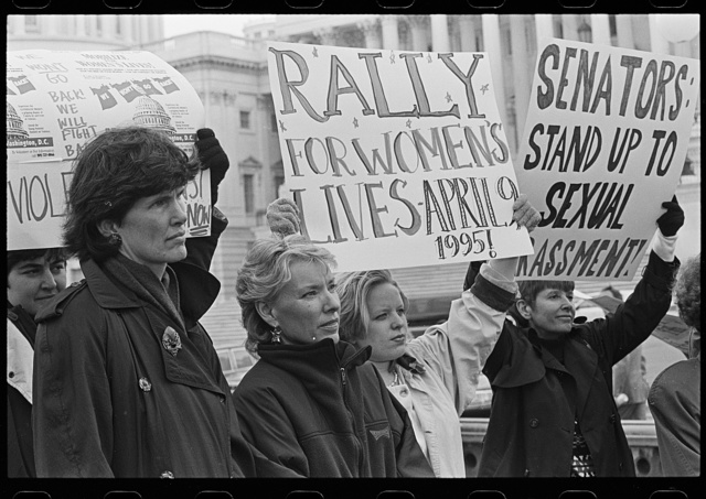 "[Women outside the U.S. Capitol holding signs supporting the National Organization for Women's ""Rally for Women's Lives"" and against sexual harassment, probably in reference to the accusations against Senator Bob Packwood]"