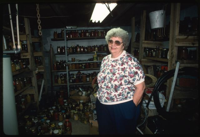 Edna Turner in her cellar with produce that she has canned