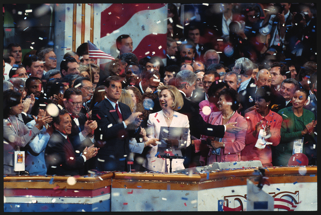 [President Bill Clinton, Hillary Clinton, Vice President Al Gore, Senator Paul Simon and others on stage celebrating the nomination of Bill Clinton as the Democratic Party candidate for president, at the 1996 Democratic National Convention in Chicago]