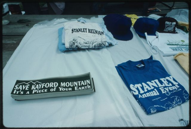 Table of bumper stickers and t-shirts either protesting mountaintop removal or proclaiming Stanley Family heritage