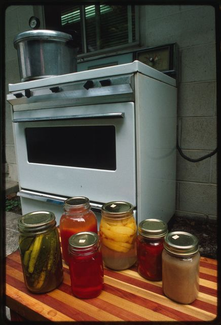 Variety of foods canned by Vivian Jarrell including sweet pickles, tomato juice, peach jelly, apples, garden relish, golden delicious applesauce, and string beans