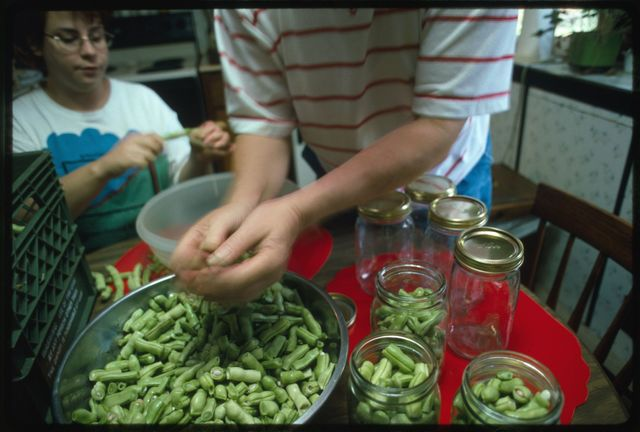 Vicky and Vivian Jarrell preparing string beans for canning