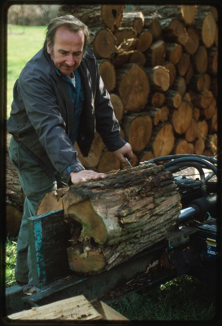 Woody Boggs splitting wood at Gail Ballard's house