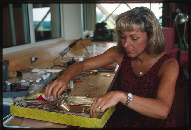 Jane Atanat Embrey making pins using stamps, glass, copper foil, ribbon, and fabric