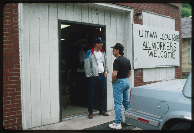 Jess Duncan speaks with a miner outside the United Mine Workers of America (UMWA) union hall in Sundial, WV