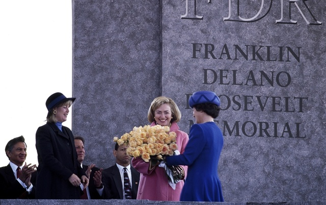 Princess Margriet of the Netherlands presents First Lady Hillary Clinton with a bouquet at the 1997 dedication of the Franklin Delano Roosevelt Memorial in Washington, D.C.