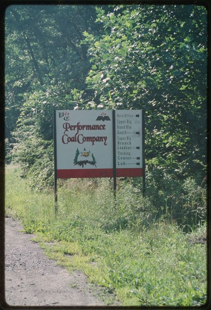 """Sign at the entrance to the community of Montcoal:  """"Performance Coal Company"""""""