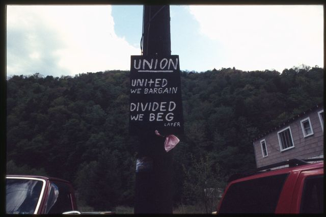 """Sign outside the United Mine Workers of America (UMWA) union hall:  """"United We Bargain, Divided We Beg"""""""