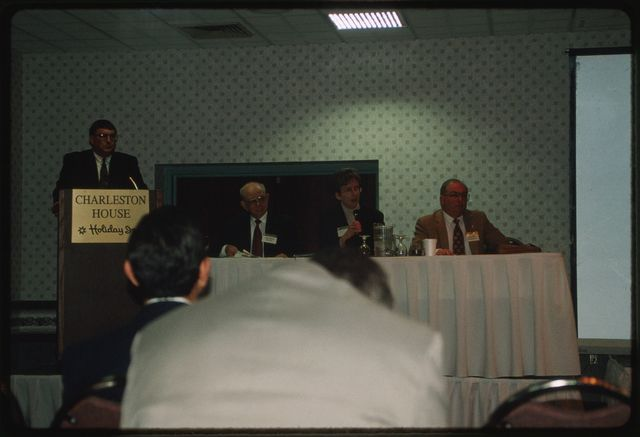 Ben Greene, chairman of the West Virginia Surface Mining and Reclamation Association, introducing panelists from the Division of Environmental Protection during the 1998 Coal Symposium