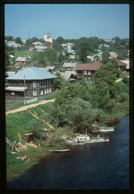 Left bank of Sukhona River, with wooden houses (19th-20th centuries), Tot'ma, Russia