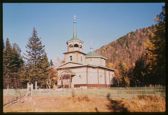Autumn panorama, with log Church of Saint Nicholas (1846), southwest view, which was originally built near the site where Lake Baikal drains into the Angara River, Listvianka, Russia