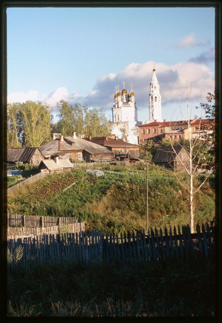 Church of the Trinity (1703-12), northwest panorama, with log houses (19th-20th centuries), and garden plots in foreground, Verkhotur'e, Russia