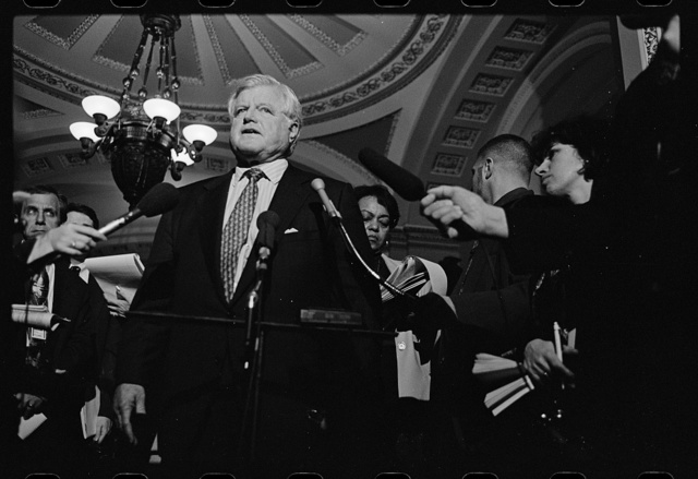 [Senator Ted Kennedy being interviewed by reporters in the corridors of the U.S. Capitol during the Senate impeachment trial of President Bill Clinton]