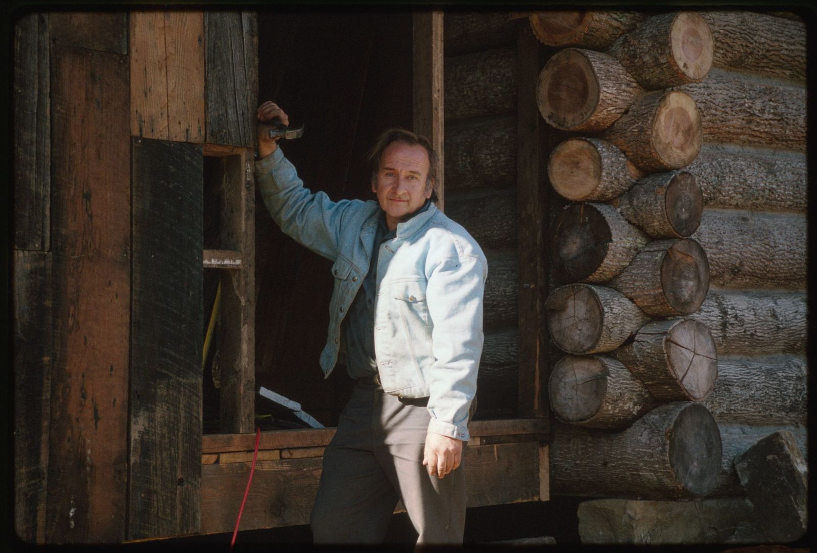 Woody Boggs, recycling the wormy chestnut timbers from the dismantled Coffee Pot into a kitchen for a new log cabin in Pettry Bottom
