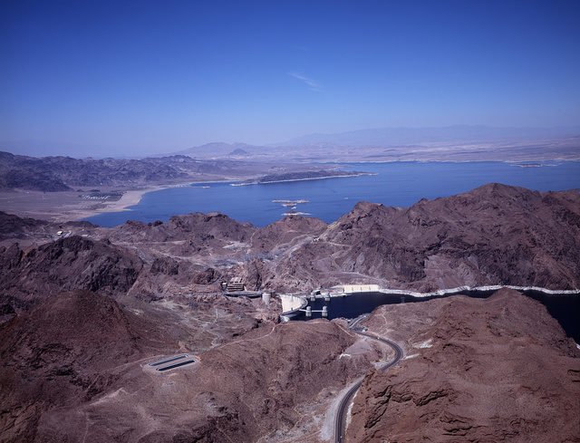 Aerial view of Boulder Dam with Lake Mead in the background Image. Boulder City, Nevada