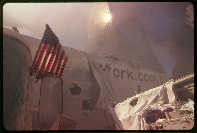 [American flag amid rubble following September 11th terrorist attack on World Trade Center, New York City]