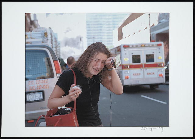 [Crying woman standing in street with ambulance in background, following the September 11th terrorist attack on the World Trade Center, New York City] / Don Halasy.