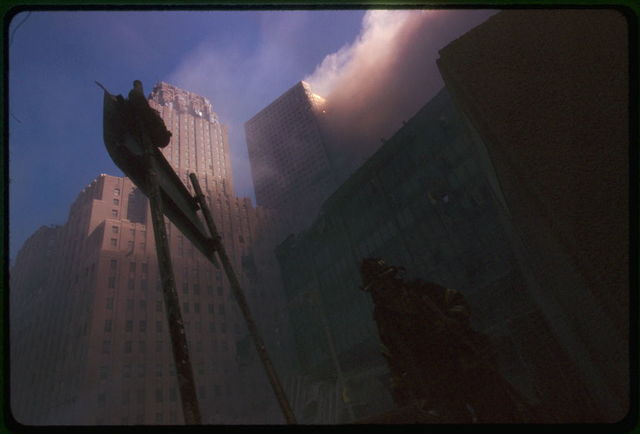 [Fire fighter at base of burning building following September 11th terrorist attack on World Trade Center, New York City]