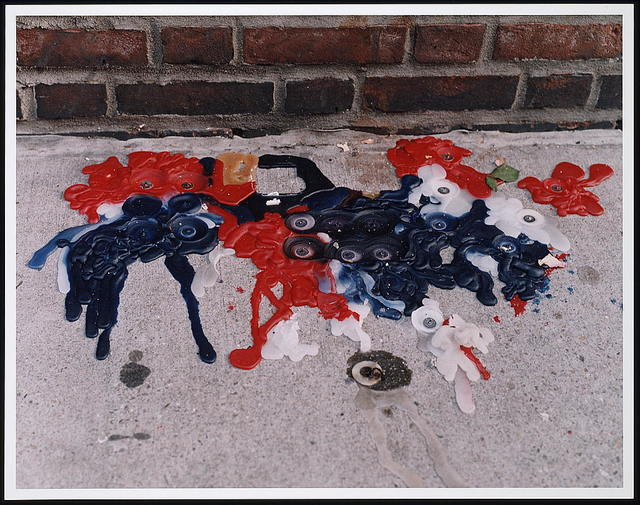 [Melted red, white, and blue candle wax on a sidewalk, following the September 11th terrorist attack on the World Trade Center, New York City]