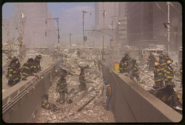 [Rescue workers amid debris following September 11th terrorist attack on World Trade Center, New York City]