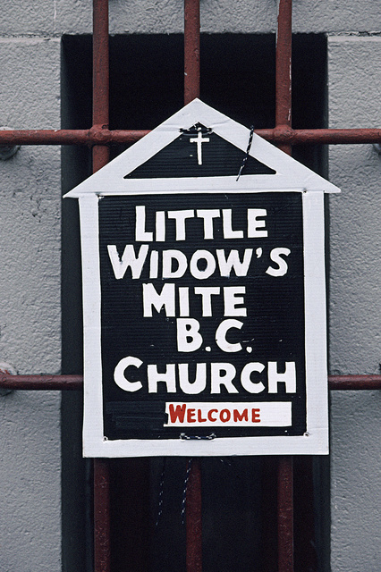 Portable sign to advertise Sunday services, of Little Widow's Mite M. B. Church, placed on the Bronx temple. Seventh Day Adventist Church, where they rent space, Willis Ave. at E. 147th St., Bronx, 2004