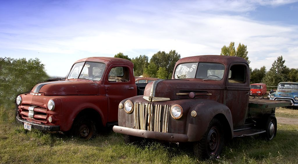 Antique trucks along the road, Montana