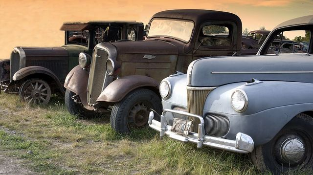 Antique trucks and cars along the road, Montana