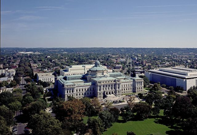 [Aerial view showing the Library of Congress Thomas Jefferson Building, with East Capitol Street on the left and the James Madison Building on the right, Washington, D.C.]