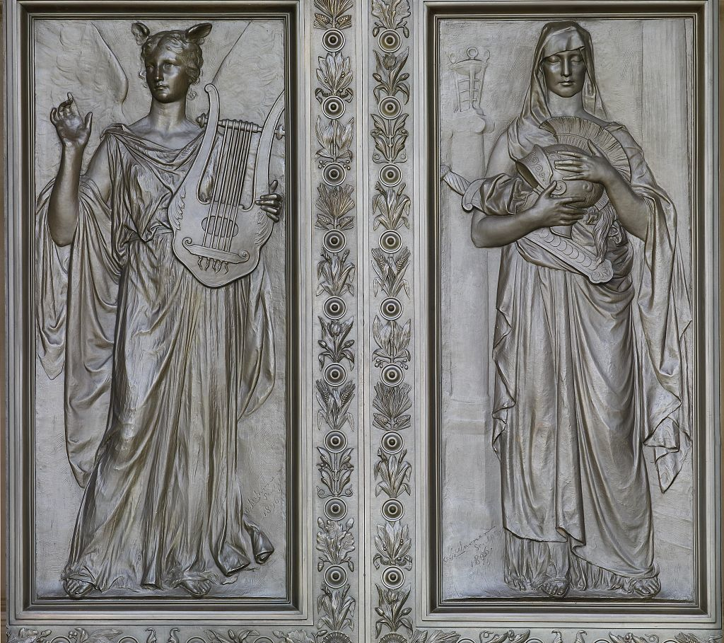 [Exterior view. Bronze doors at the main entrance with female figures representing Imagination (woman holding a lyre) and Memory (woman holding a helmet), by Olin L. Warner. Library of Congress Thomas Jefferson Building, Washington, D.C.]