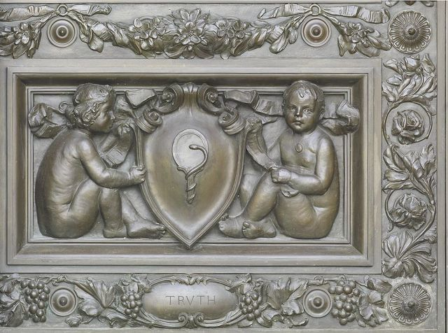 [Exterior view. Detail of bronze doors at the main entrance with cherubs representing Truth (holding a cartouche with mirror and a serpent), by Olin L. Warner. Library of Congress Thomas Jefferson Building, Washington, D.C.]