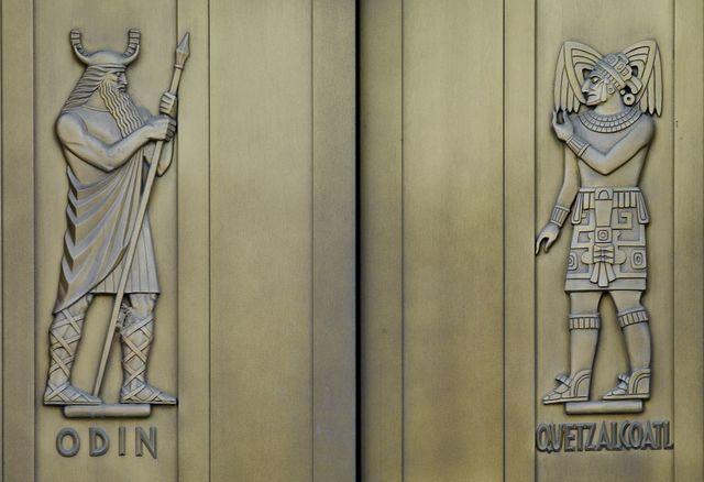 [Exterior view. Door detail, east entrance. Odin and Quetzalcoatl, sculpted bronze figures by Lee Lawrie. Library of Congress John Adams Building, Washington, D.C.]
