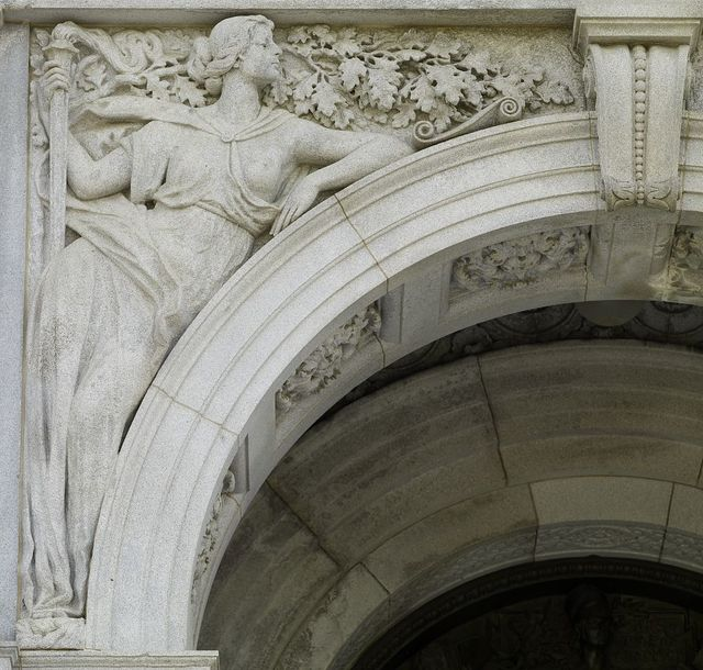 [Exterior view, entrance porch. Granite sculpture with female figure representing Science (holding the torch of knowledge), by Bela Lyon Pratt. Library of Congress Thomas Jefferson Building, Washington, D.C.]