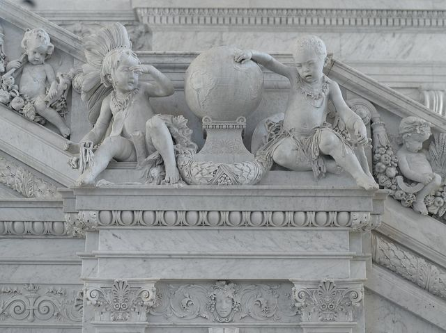 [Great Hall. Detail of cherubs representing America and Africa on the Grand staircase by Philip Martiny. Library of Congress Thomas Jefferson Building, Washington, D.C.]