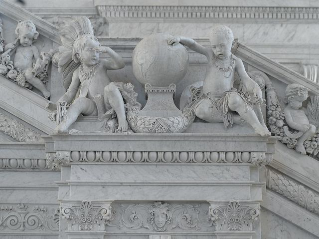 [Great Hall. Detail of cherubs representing America and Africa with putti (fisherman and farmer) on Grand staircase by Philip Martiny. Library of Congress Thomas Jefferson Building, Washington, D.C.]