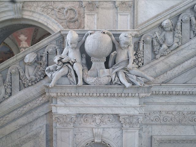 [Great Hall. Detail of cherubs representing Asia and Europe on the Grand staircase by Philip Martiny. Library of Congress Thomas Jefferson Building, Washington, D.C.]
