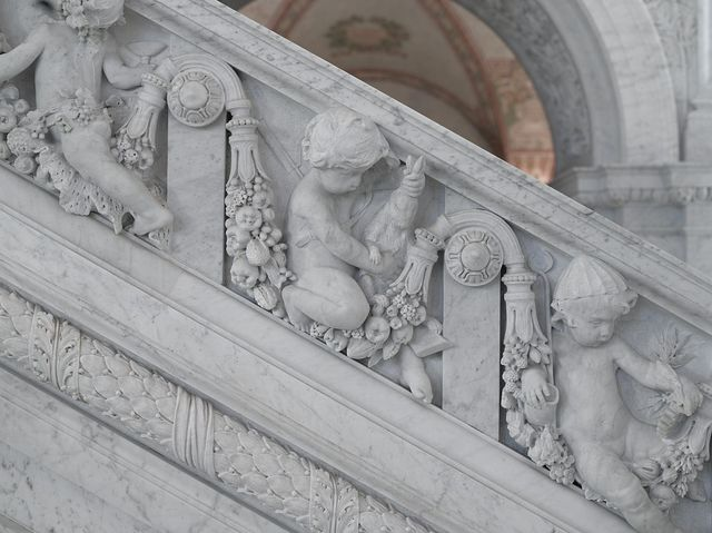 [Great Hall. Detail of putti (hunter and mechanic) on Grand staircase by Philip Martiny. Library of Congress Thomas Jefferson Building, Washington, D.C.]