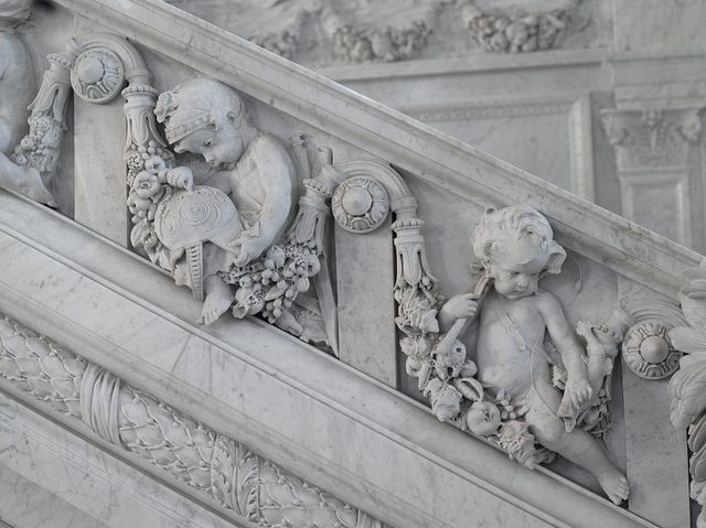 [Great Hall. Detail of putti (Mars and fisherman) on Grand staircase by Philip Martiny. Library of Congress Thomas Jefferson Building, Washington, D.C.]