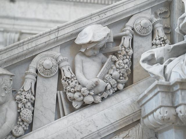 [Great Hall. Detail of putti (printer with types, press, and type case) on the Grand staircase by Philip Martiny. Library of Congress Thomas Jefferson Building, Washington, D.C.]