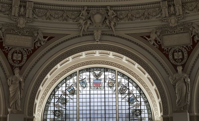 [Main Reading Room. Semi-circular stained glass window in alcove by H.T. Schladermundt with statues of Religion and Science on either side. Library of Congress Thomas Jefferson Building, Washington, D.C.]