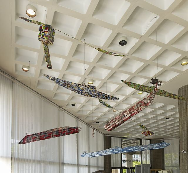 "Sculpture ""Flotilla of Kayaks in a Tropical Storm"" suspended in lobby, Milio Building, New York, New York"