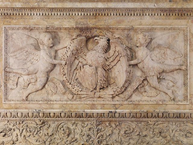 [Senate Members Room. Detail of carved mantel of the Siena marble fireplace showing an eagle holding arrows and an American shield in its claws while being supported by cherubs. Library of Congress Thomas Jefferson Building, Washington, D.C.]