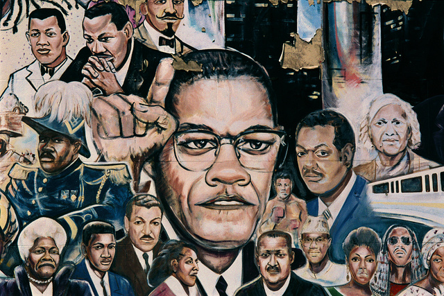 "Mural ""African Amalgamation of Ubiquity,"" by Curtis Lewis, 1985, featuring Malcolm X and MLK, Jr., on the side wall of Operation Get Down, a drug rehabilitation center, 9980 Gratiot  Avenue, Detroit, Michigan, 2008"