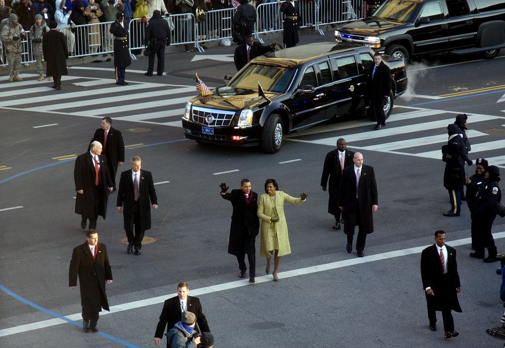 2009 Inaugural Parade, January 24th. Barack and Michelle Obama walk in front of the new Presidential Inaugural car, Pennsylvania Avenue at 15th Street, N.W., Washington, D.C.