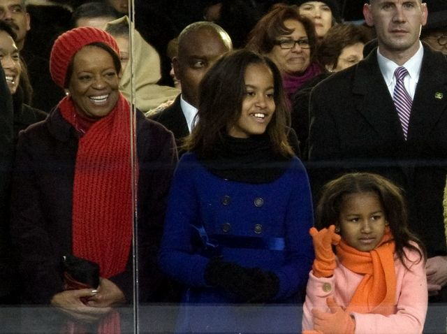 2009 Inaugural Parade. Michelle Obama's mother, Marian Shields Robinson views parade with Malia and Sasha Obama behind glass in the viewing stand in front of the White House, Washington, D.C.
