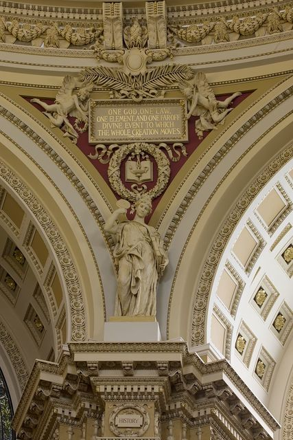 [Main Reading Room. View of statue of History by Daniel Chester French on the column entablature between two alcoves. Library of Congress Thomas Jefferson Building, Washington, D.C.]