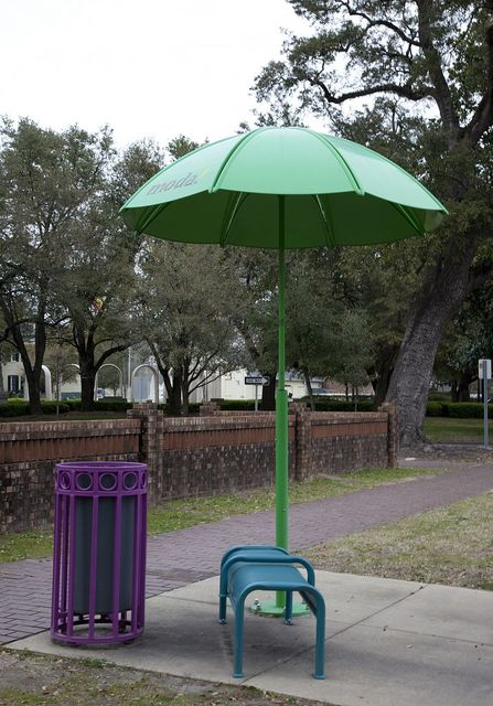 A colorful bench, umbrella and trash can adorn the city streets in many places in Mobile, Alabama