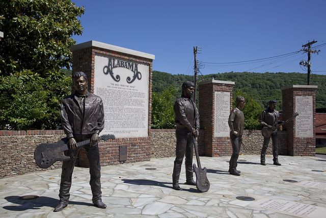[Bronze statues, members of] Alabama, a Grammy Award-winning country music and southern rock band that originated in Fort Payne, Alabama