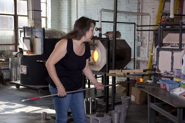 Glass blower Susan Knecht and her associate Allison Smith create art in the historic Lowe Mill in Huntsville, Alabama