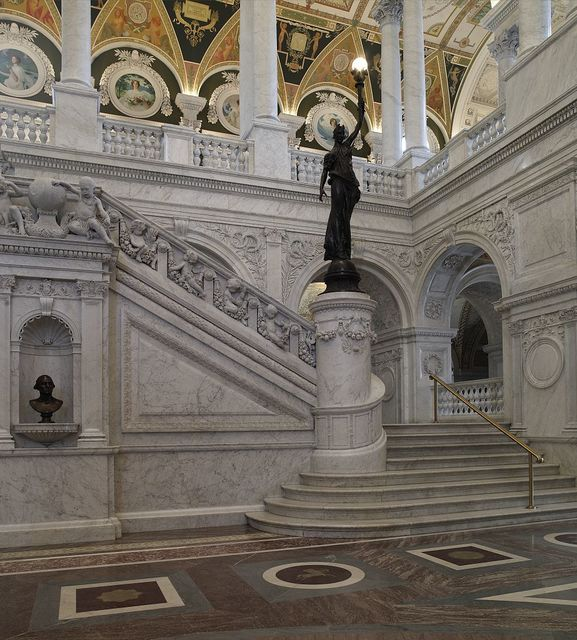 [Great Hall. View of grend staircase and bronze statue of female figure on newel post holding a torch of electric light. Library of Congress Thomas Jefferson Building, Washington, D.C.]